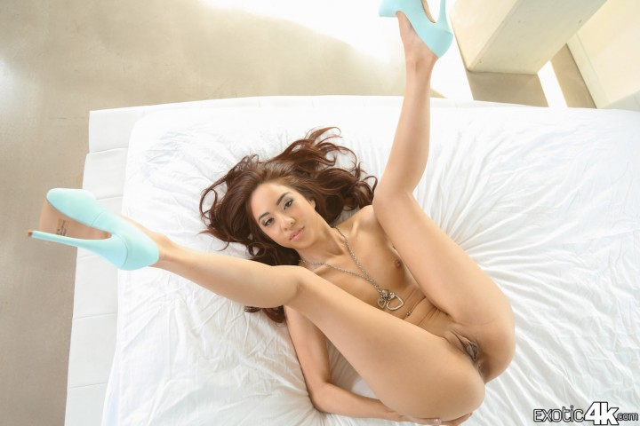 Mila Jade spread while wearing blue high heels